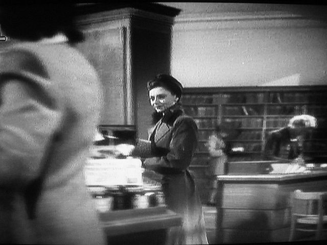 Laura walks from the library into the chemist's shop in Brief Encounter