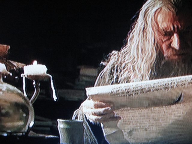 Open flames amidst the archives in Lord of the Rings: The Fellowship of the Ring