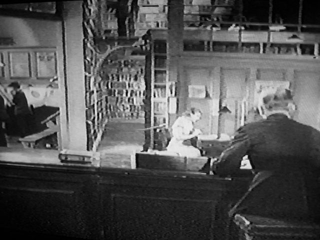 View over the reel librarian's shoulder, in The Good Companions (1933)