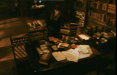 Messy reference desk in Tale of a Vampire