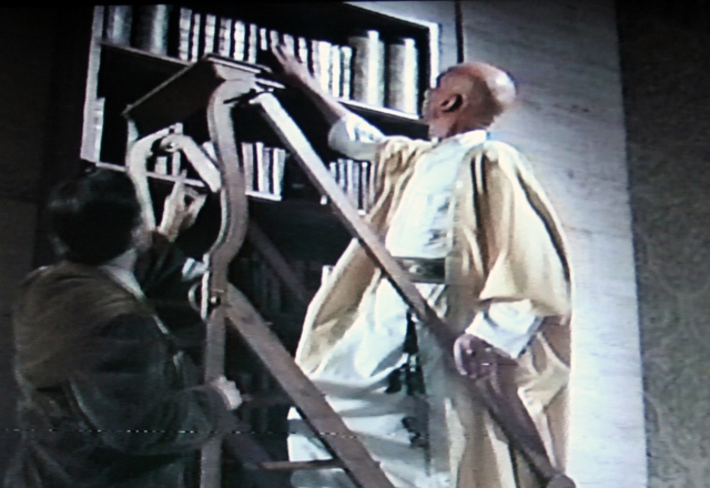 Library ladder scene in 'Necronomicon: Book of the Dead' (1993)