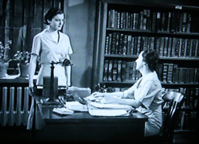 Ruth Hussy as Mary (left) and Claire Du Brey as the Prison Librarian (seated) in Within the Law