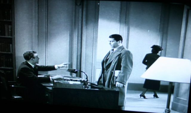 NYPL periodicals librarian in Confessions of a Nazi Spy (1939)