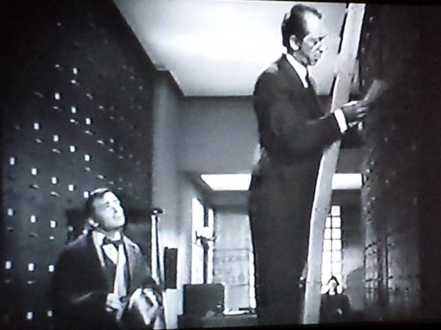 Library ladders and file cabinets in The Mask of Dimitrios (1944)