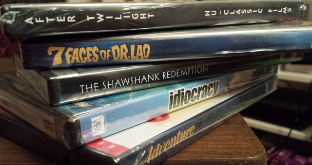Reel Librarians  |  Stack of reel librarian DVDs -- choose your own adventure
