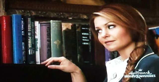 Librarian eye-rolling in A Bone to Pick: An Aurora Teagarden Mystery (2015)