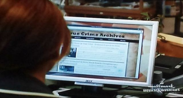 Roe researching in A Bone to Pick: An Aurora Teagarden Mystery (2015)