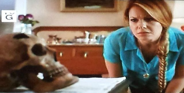 Reel Librarians  |  Roe studies a skull in 'A Bone to Pick:  An Aurora Teagarden Mystery' (2015)