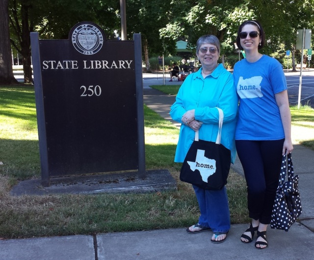 Reel Librarians | Posing by the Oregon State Library sign