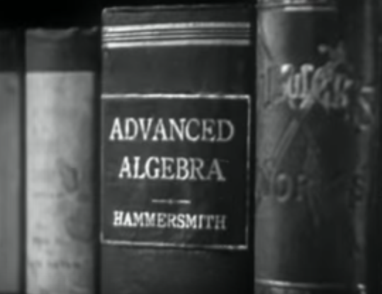Closeup of library book in Navy Blues (1937)