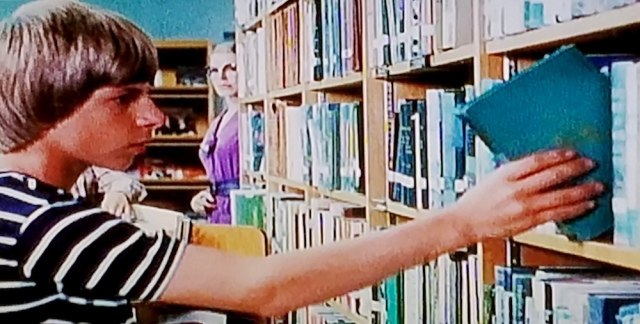 Librarian observes Jamie in The Pit (1981)
