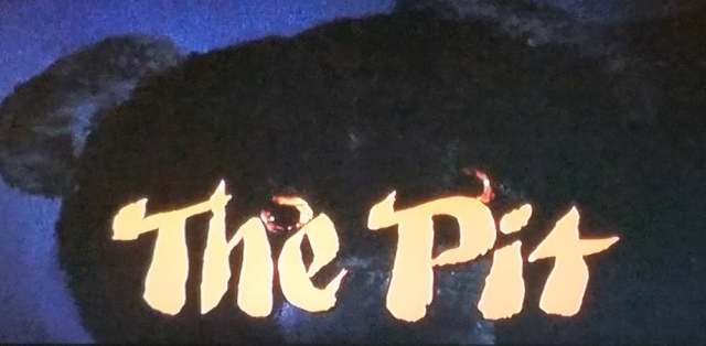Title card from The Pit (1981)