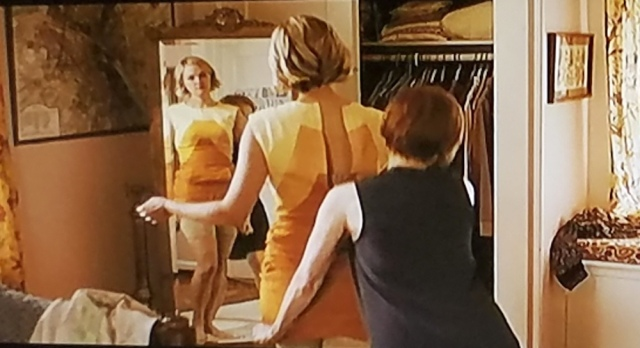 A reel librarian in her Spanx underwear, trying on outfits for a date