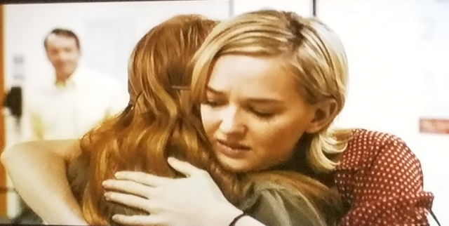 The two sisters, Katy and Eleanor, hug in The Disappearance of Eleanor Rigby (2014)