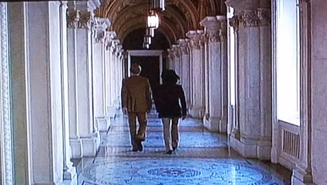 Woodward and Bernstein walk a column-lined hallway of the Library of Congress