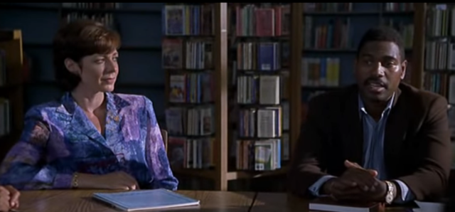 The school librarian and Dwayne, an adult literacy learner, in Primary Colors (1998)