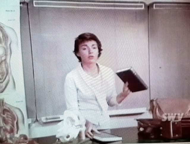 Miss Petersen introduces the two textbooks for the new sex education class, in Teenage Mother (1967)