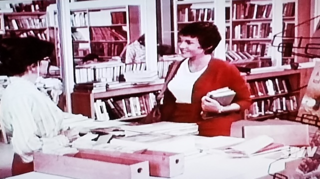 The school librarian and the new health teacher meet in Teenage Mother (1967)