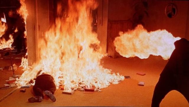 Reel Librarians | Montag torches his own captain in a scene from 'Fahrenheit 451' (1966)