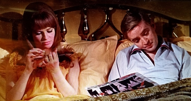 """Montag """"reads"""" the comics while in bed with his wife, in an early scene from Fahrenheit 451 (1966)"""