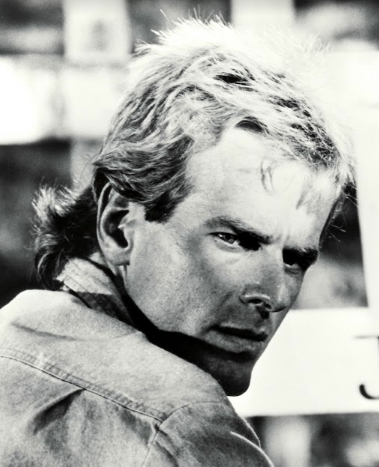 Working as a stand-in for Richard Dean Anderson on MacGyver (complete with mullet!), photo courtesy of Bill Nikolai