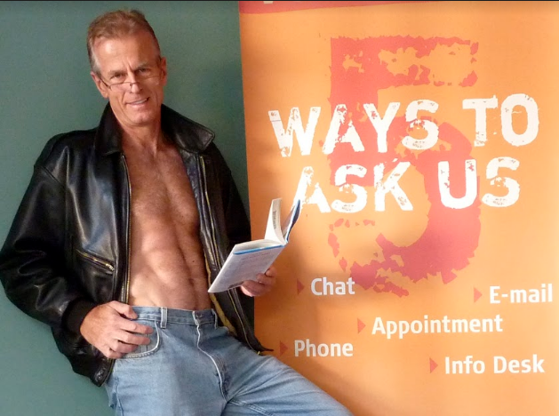 """""""Ask a Librarian"""" indeed! Photo for """"Men of IT"""" charity calendar for VCC, courtesy of Bill Nikolai"""