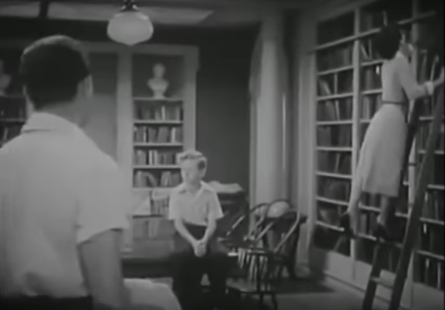 Still from library ladder scene in Katie Did It (1951)