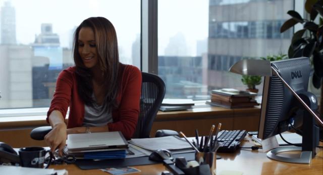 Rachel Zane at her desk