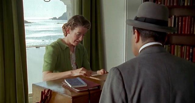 The librarian flips through the patron files