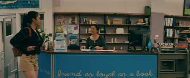 Exchanging smiles with the reel librarian inTo All the Boys I've Loved Before (2018)