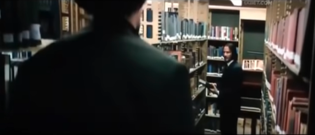 Ernest towers over John Wick, as seen in the library fight scene in John Wick: Chapter 3 - Parabellum