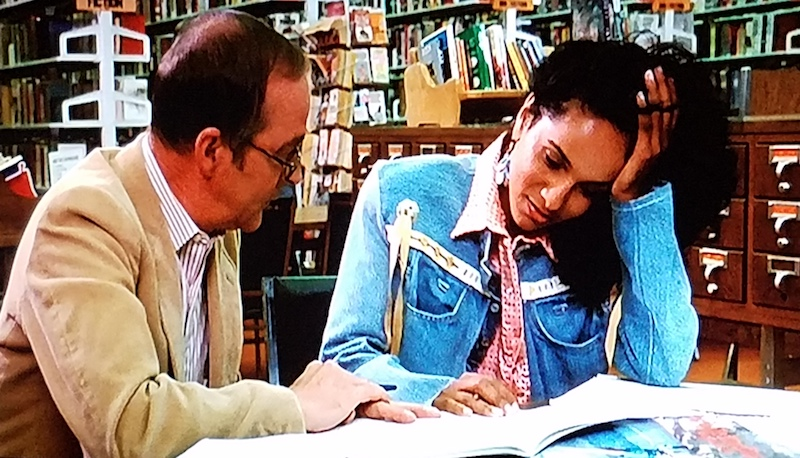 Denise and a reading tutor meet up in the school library in Summer School (1987)
