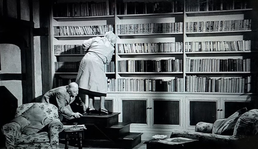 Mr. Stringer pushes Miss Marple on a library ladder in her own private library in Murder Ahoy! (1964)