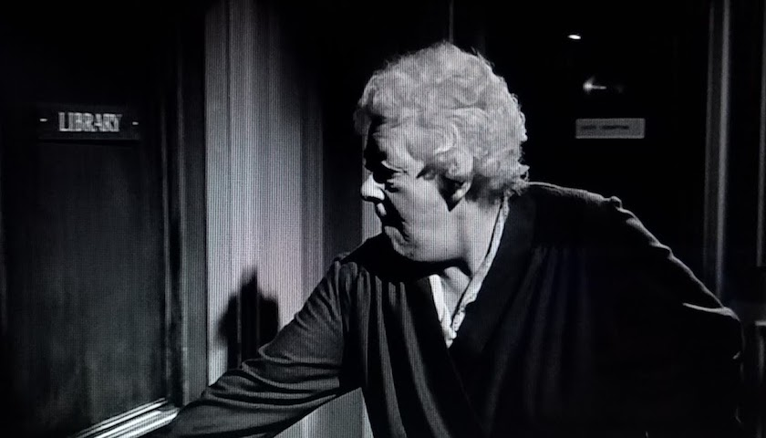 Miss Marple enters the ship's library, which is clearly marked