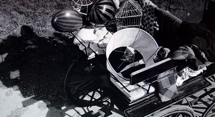 Mr. Stringer hides in a wagon of junk in a scene from Murder Most Foul (1964)