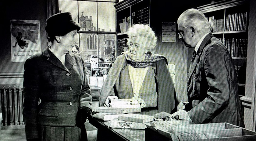 Miss Marple and Mrs. Stainton throw shade at each other during the village library scene in Murder, She Said (1961)