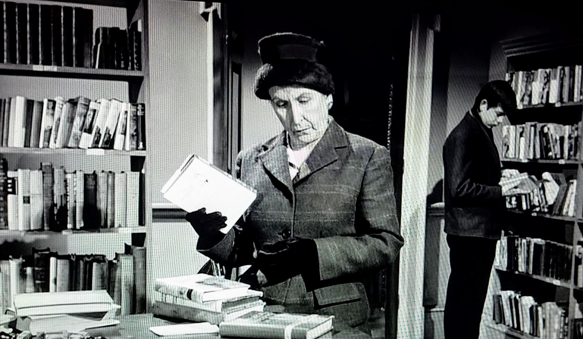 Mrs. Stainton spies a library book in Murder, She Said (1961)