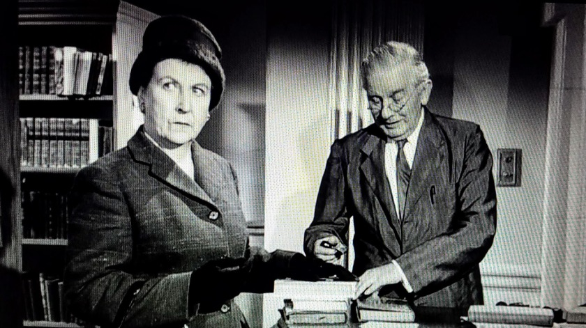 Mr. Stringer stamps a library book in Murder, She Said (1961)