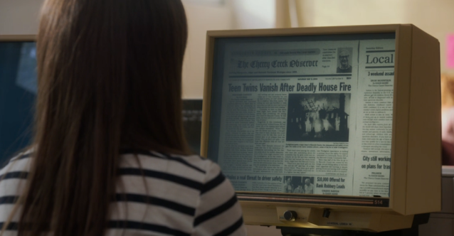 Researching past news articles on microfilm in A Simple Favor (2018)