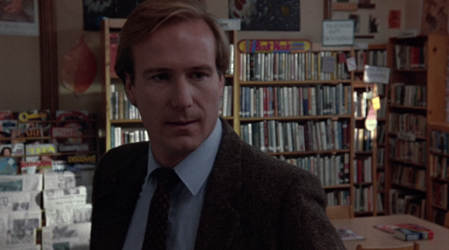"""Book Nook"" sign along the back wall of the school library in Children of a Lesser God (1986)"