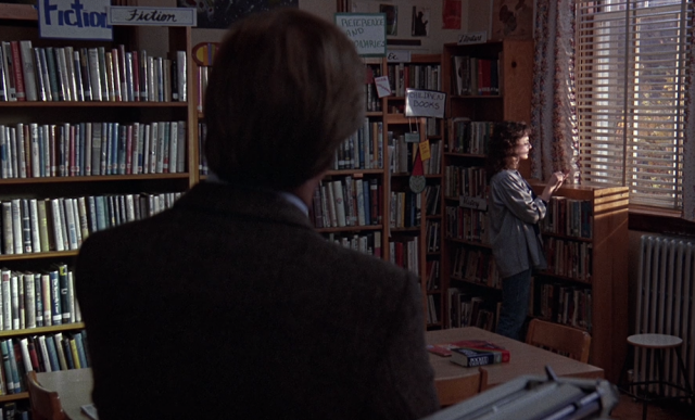 Hand-lettered signs for different collections in the school library, including Fiction, Reference and Encyclopedias, Children's Books, History, etc. From the school library scene in Children of a Lesser God (1986).