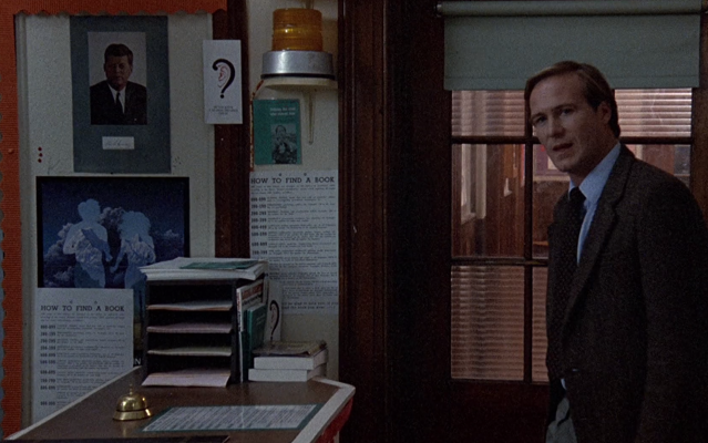 "School library counter with a bell and multiple ""How to Find a Book"" signs with Dewey Decimal call number info. Library scene in Children of a Lesser God (1986)."