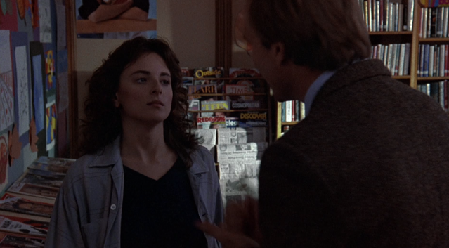 Periodicals corner of the school library, with print magazines and newspapers, in the school library scene from Children of a Lesser God (1986)